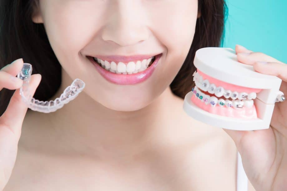 woman choosing between braces and aligners