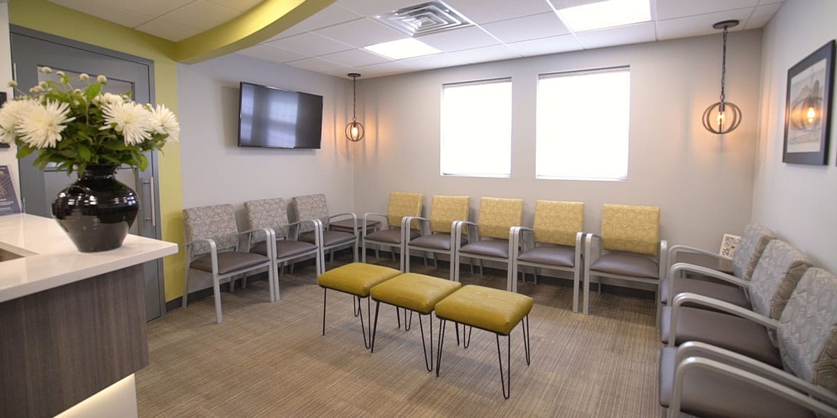 waiting room with yellow and grey chairs
